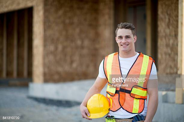 Construction Worker Standing by a New Home