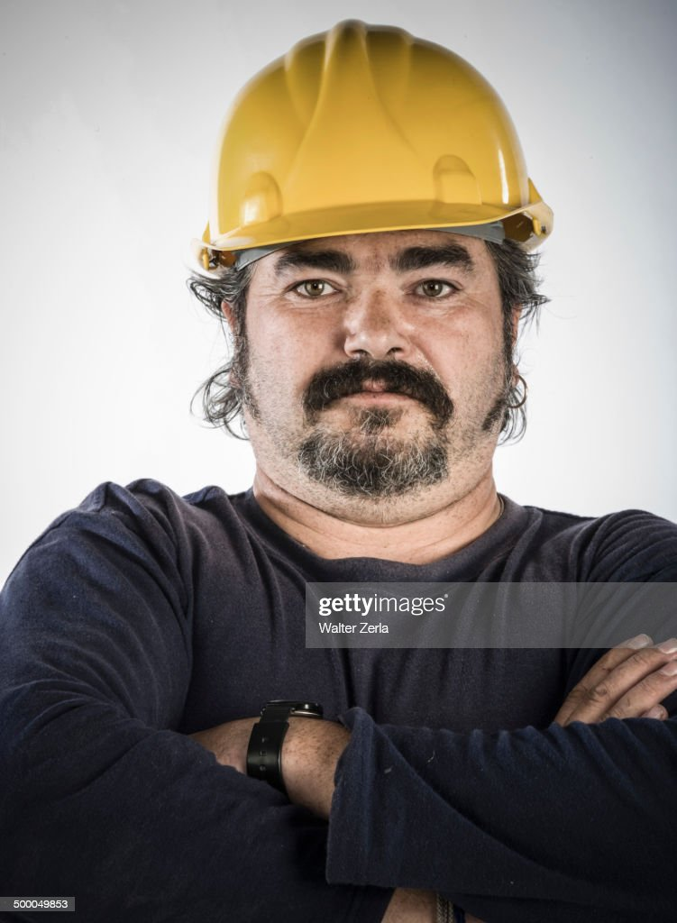 Construction worker standing with arms crossed