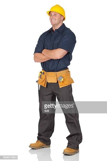 Construction worker standing with his arms crossed