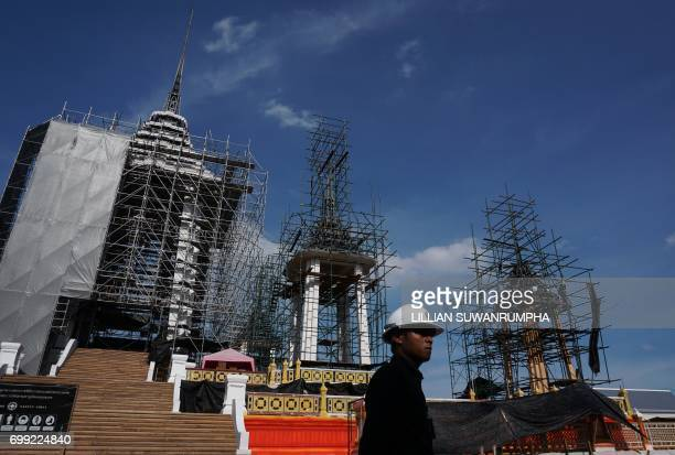 A construction worker stands in front of the funeral pyre and surrounding pavilions for the late Thai King Bhumibol Adulyadej inside Sanam Luang park...