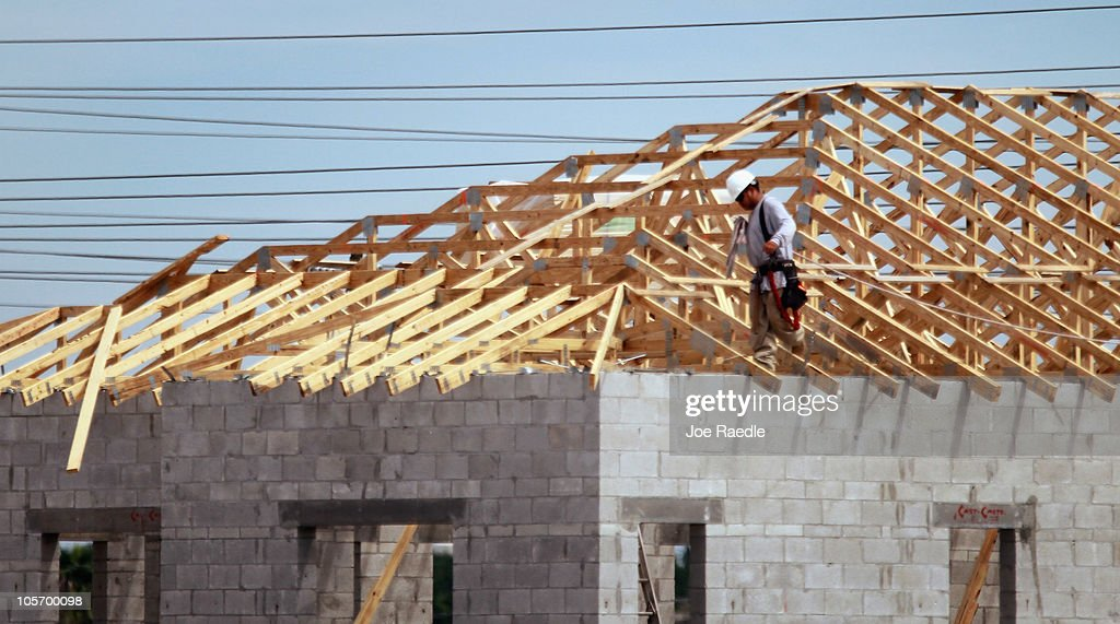 A construction worker stands in the rafters of a new home being built on October 19, 2010 in Cooper City, Florida. The Commerce Department annouced today that September housing starts rose 0.3% to 610,000, which is a five month high.