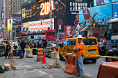 A construction worker stands in the road on 7th Avenue near Times Square in Manhattan