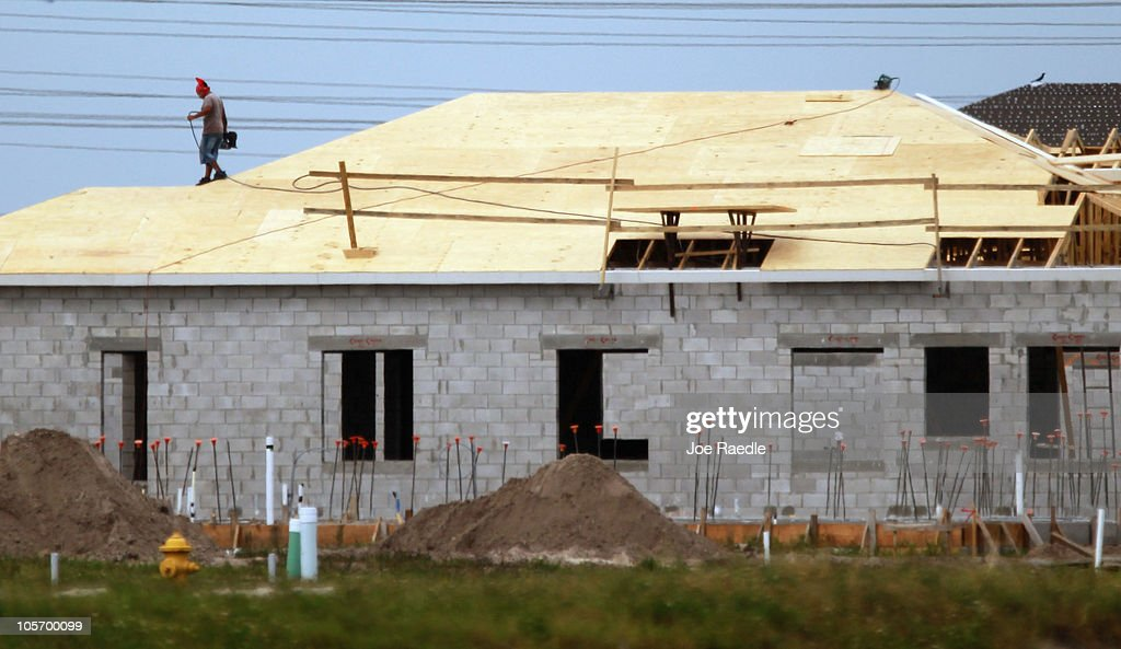 A construction worker stands on the roof of a new home being built on October 19, 2010 in Cooper City, Florida. The Commerce Department annouced today that September housing starts rose 0.3% to 610,000, which is a five month high.