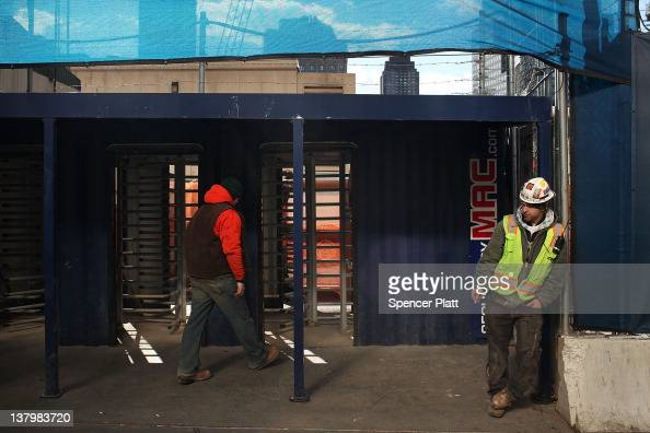 A construction worker takes a break outside of One World Trade Center the central skyscraper under construction at Ground Zero on January 30 2012 in...