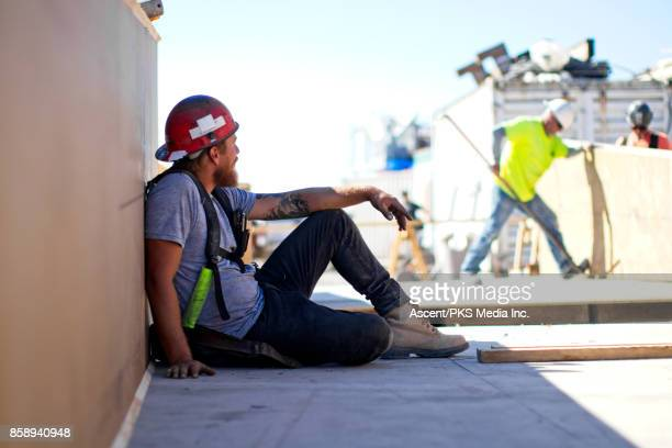 Construction worker taking a shade break