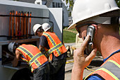 Foreman talking on a mobile phone