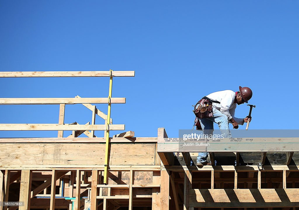 A construction worker uses a hammer at a new housing development on February 20, 2013 in San Mateo, California. The Commerce Department reported that new housing starts dropped 8.5% in January following a 15.7% increase one month earlier.
