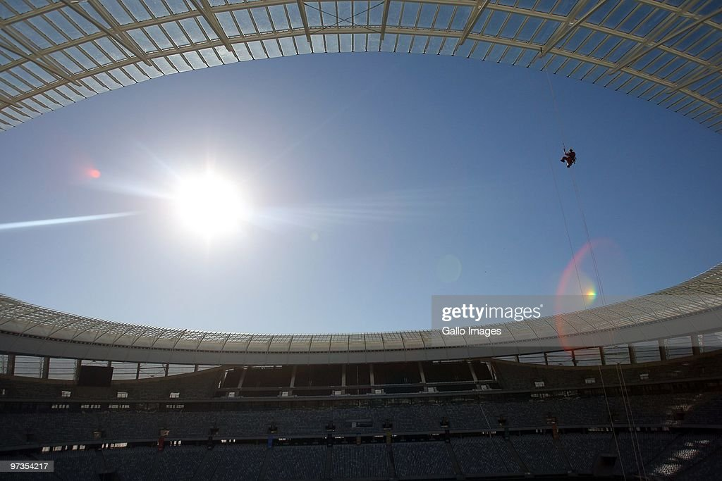 A construction worker uses ropes and a harness inside Greenpoint stadium in Cape Town during preparation work ahead of the FIFA 2010 World Cup March...