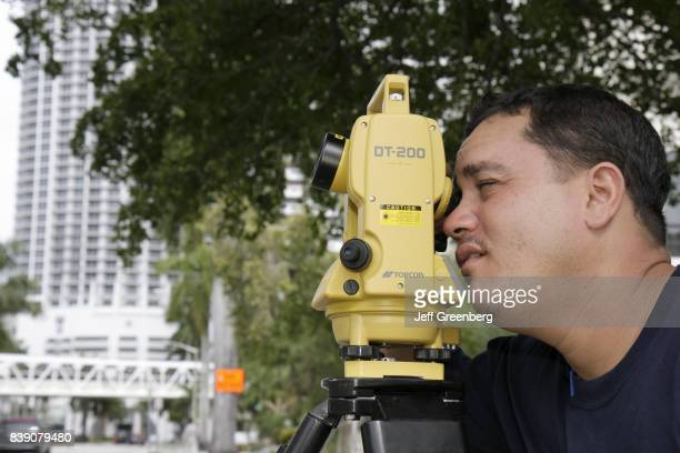 A construction worker using a Topcon in Miami