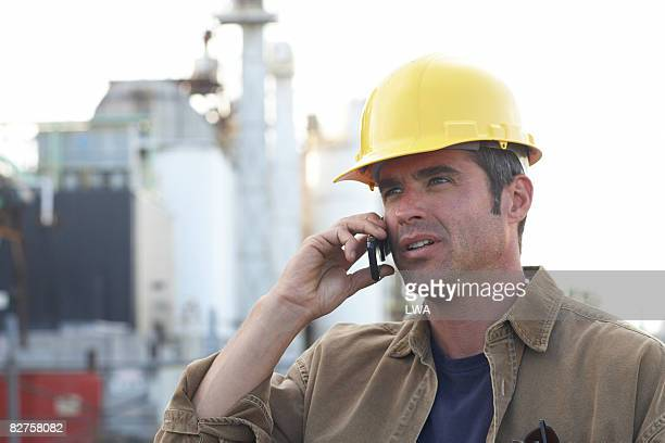 Construction Worker Using Cell Phone at Work Site