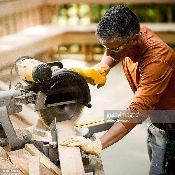Construction Worker Using Miter Saw for Deck