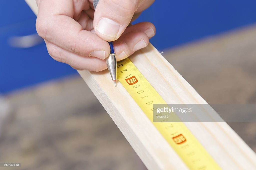 Construction Worker Using Tape Measure : Stock Photo