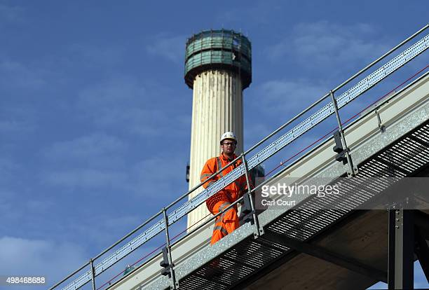 A construction worker walks along a conveyor belt for excavated soil at Battersea Power Station on November 23 2015 in London England The power...