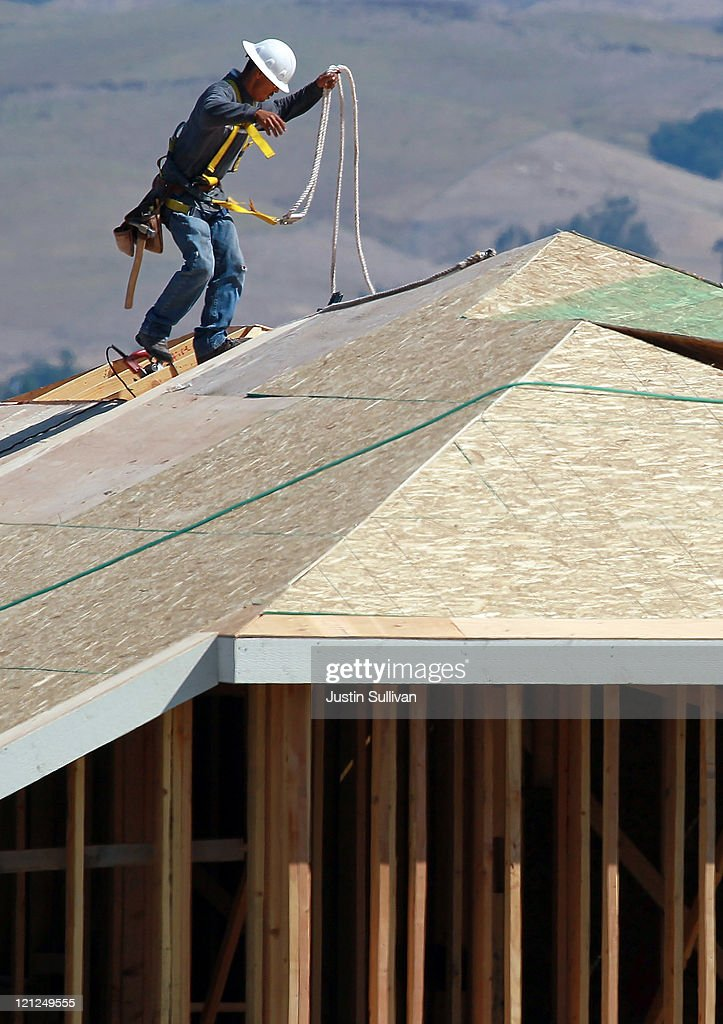 A construction worker walks on the roof of a home under construction at a new housing development on August 16, 2011 in Petaluma, California. The Commerce Department reported that new home construction fell in July with homebuilders beginning construction on a seasonally adjusted 604,000 homes for the month, a 1.5 percent decline from June.