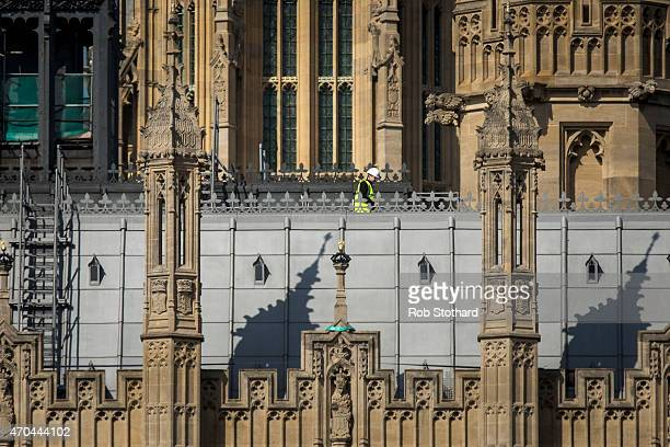 A construction worker walks on the roof of the Houses of Parliament on April 20 2015 in London England John Bercow the Speaker of the House of...