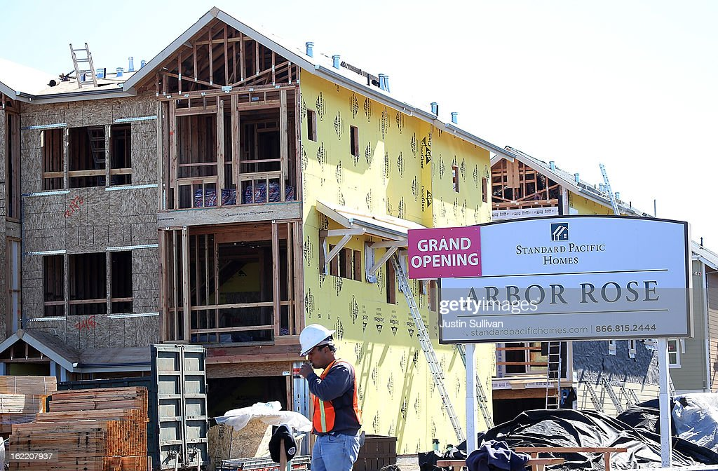 A construction worker walks past a sign at the Arbor Rose housing development on February 20, 2013 in San Mateo, California. The Commerce Department reported that new housing starts dropped 8.5% in January following a 15.7% increase one month earlier.