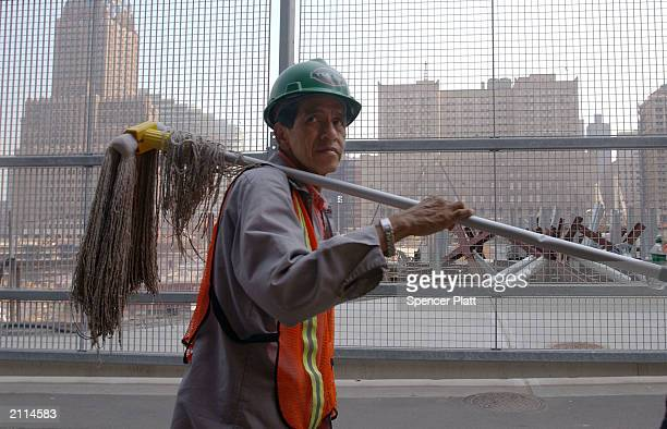 A construction worker walks past a viewing gallery at the site of the September 11 2001 terrorist attacks June 26 2003 in New York City The former...