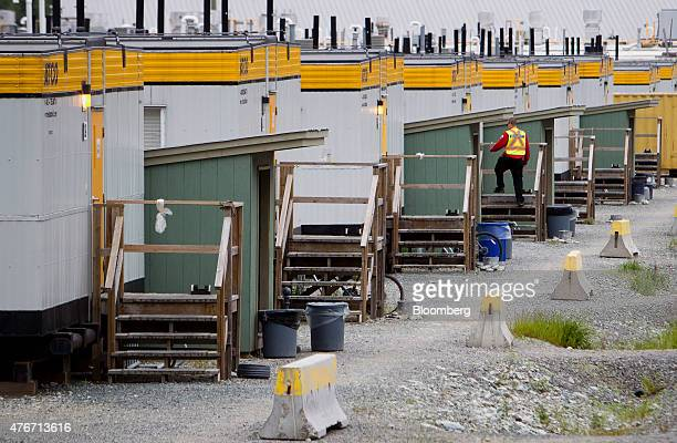 A construction worker walks past a work camp at the Rio Tinto Alcan Inc smelter facility in Kitimat British Columbia Canada on Friday June 5 2015...