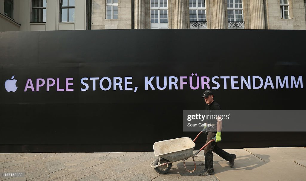 A construction worker walks past the construction site of the new Apple Store on Kurfuerstendamm avenue on April 22, 2013 in Berlin, Germany. The store is due to open in May and will the be the first Apple Store to open in the Germany capital.