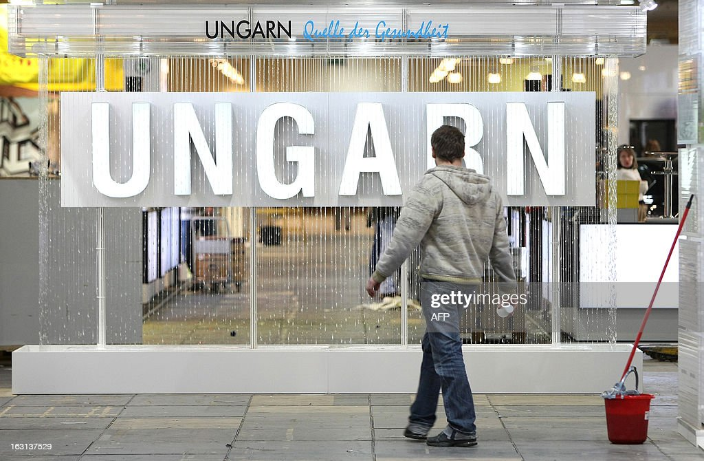 A construction worker walks through the stand of Hungary at the ITB Berlin tourism convention (Internationale Tourismus-Boerse) prior to its opening in Berlin on March 5, 2013. The ITB Berlin runs from March 6-10 and features Indonesia as its partner country for the event in 2013. AFP PHOTO / ADAM BERRY