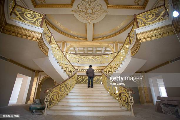 A construction worker walks up the staircase inside the replica White House a $20million villa being built inside Dream City a new exclusive...