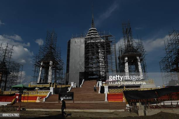 A construction worker walks up to the funeral pyre and surrounding pavilions for the late Thai King Bhumibol Adulyadej inside Sanam Luang park in...