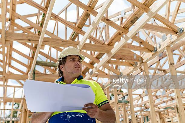 Construction worker with building plan