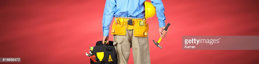 Construction worker with helmet and hammer. : Stock Photo