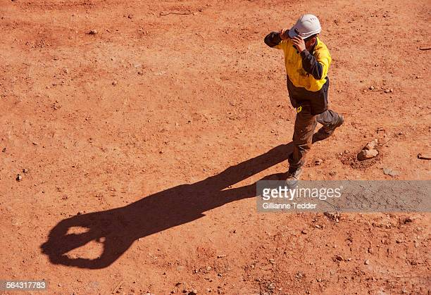 Construction worker with long shadow