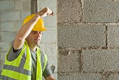 Construction worker with plumb bob