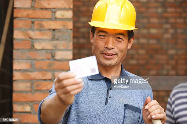 Construction worker with train ticket