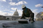 A construction worker works in front of the United States Capitol during construction of The Capitol Visitor Center December 14 2004 in Washington DC...