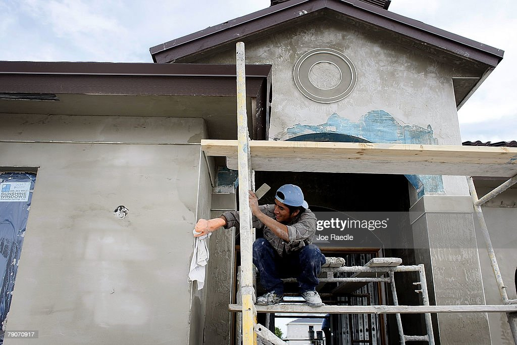 A construction worker works on a home under construction January 17, 2008 in Miami, Florida. The Commerce Department released figures showing that new home construction is down 24.8 percent from 2006.