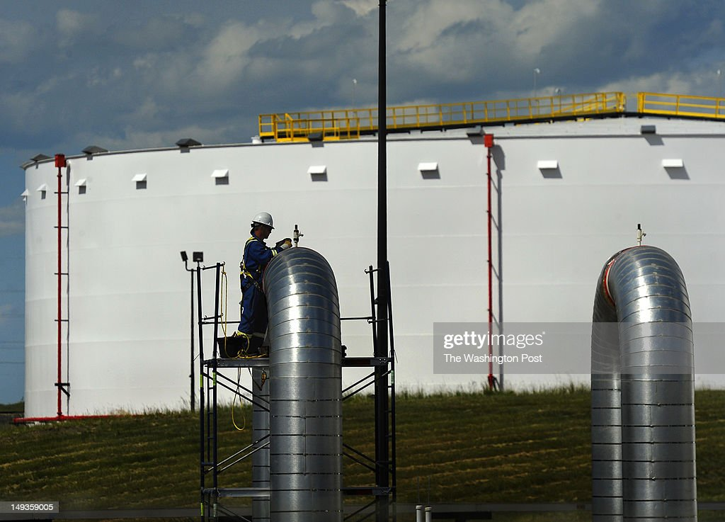 A construction worker works on one of the pumping station outlets at the under construction Hardisty pipeline depot A massive construction project is...
