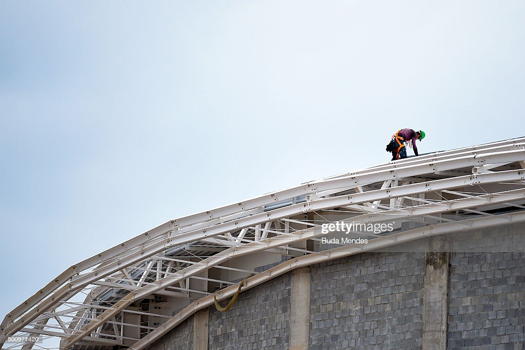 A construction worker works on the roof of the Rio Olympic Velodrome in preparation for the Rio 2016 Olympics at Olympic Park on December 11 2015 in...
