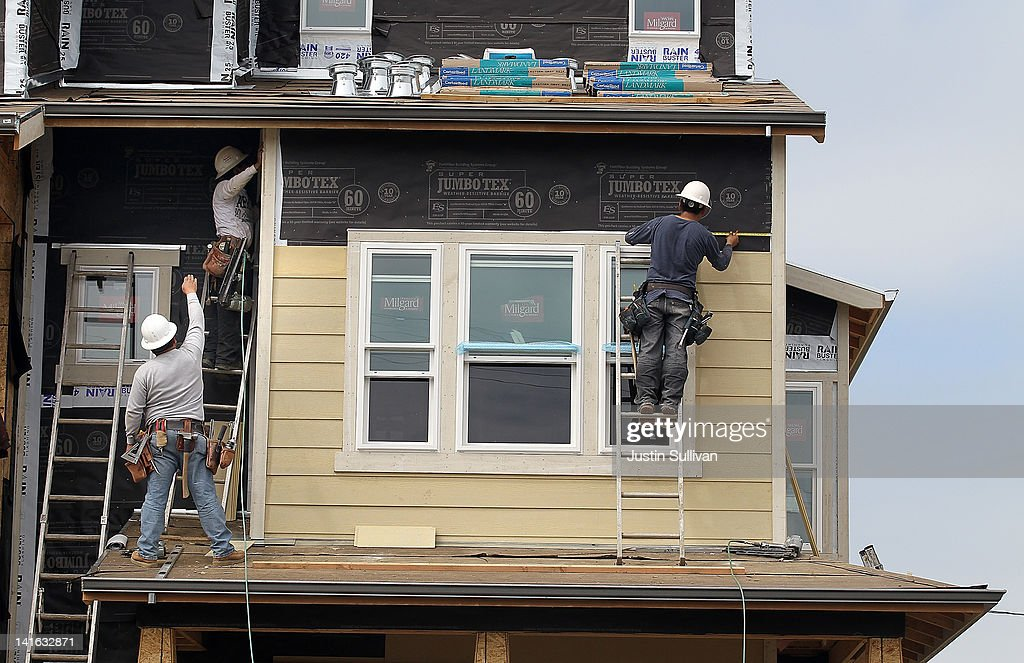 Construction workers add siding to new homes at the Arbor Rose housing development on March 20, 2012 in San Mateo, California. The Commerce Department reported today that new building permits rose 5.1 percent in February, the highest since October 2008.