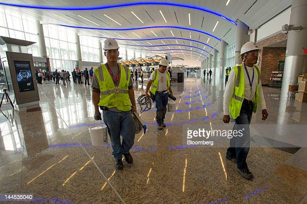 Construction workers Alex Silva from left Jose Alvarez and Cantrell Rogers look for areas to caulk at the Maynard H Jackson Jr International Terminal...