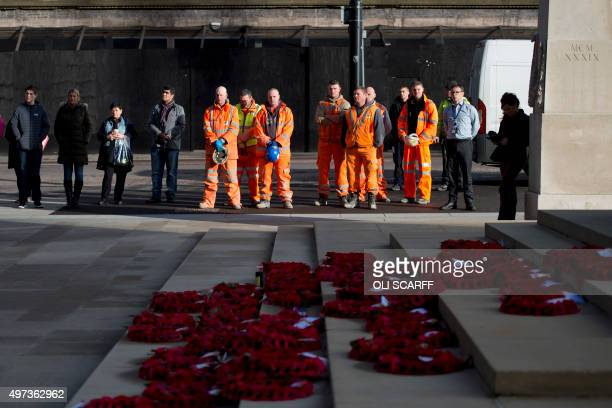 Construction workers and office staff observe a minute of silence in tribute to victims of the November 13 Paris attacks at the Cenotaph in...