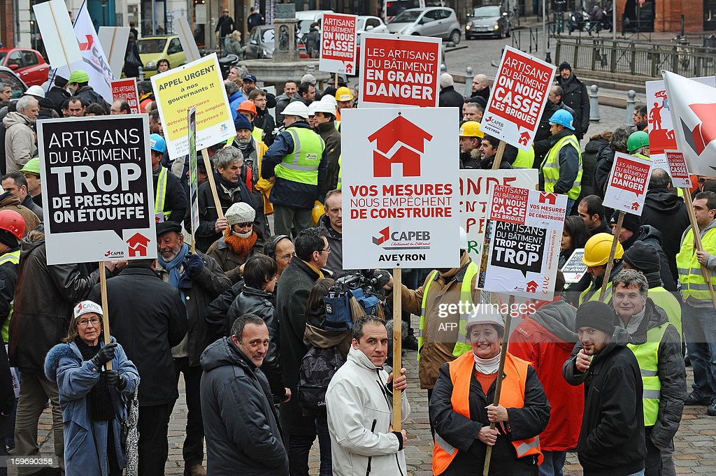 Construction workers and professionals in the building sector hold signs during a demonstration called by the CAPEB, a French union for small-sized craft enterprises, to denounce the increase of the rate of the value added tax (VAT) from seven to ten percent, on January 18, 2013 in Toulouse. Under plans designed to boost the country's competitiveness, the Socialist administration announced 20 billion euros of tax breaks for businesses that will be partly financed by increases in VAT from January 1, 2014.