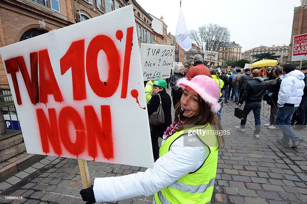 Construction workers and professionals in the building sector hold signs reading ''No to the VAT at 10%'during a demonstration called by the CAPEB, a French union for small-sized craft enterprises, to denounce the increase of the rate of the value added tax (VAT) from seven to ten percent, on January 18, 2013 in Toulouse. Under plans designed to boost the country's competitiveness, the Socialist administration announced 20 billion euros of tax breaks for businesses that will be partly financed by increases in VAT from January 1, 2014.
