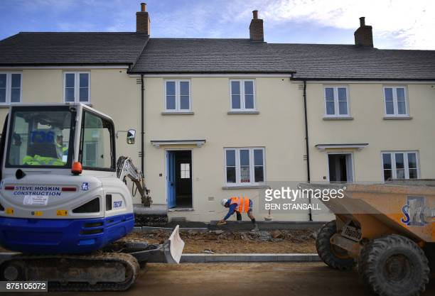 Construction workers are busy at Nansledan housing development championed by Britain's Prince Charles Prince of Wales at Newquay town in Cornwall on...