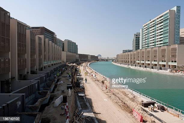 Construction workers are seen beside a canal at the Khor Al Raha beach development in Abu Dhabi United Arab Emirates on Tuesday Jan 10 2012 Abu Dhabi...
