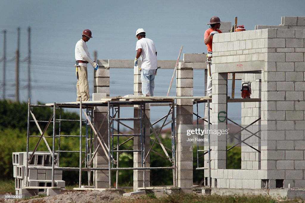 Construction workers are seen building a new home on October 19, 2010 in Cooper City, Florida. The Commerce Department annouced today that September housing starts rose 0.3% to 610,000, which is a five month high.
