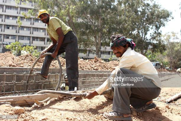 Construction workers are seen on a construction site on March 25 2010 in Chandigarh India