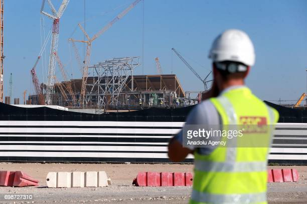 Construction workers are seen outside the construction site of new Al Bayt Stadium in Al Khor Qatar on June 20 2017 The stadium will be a venue for...