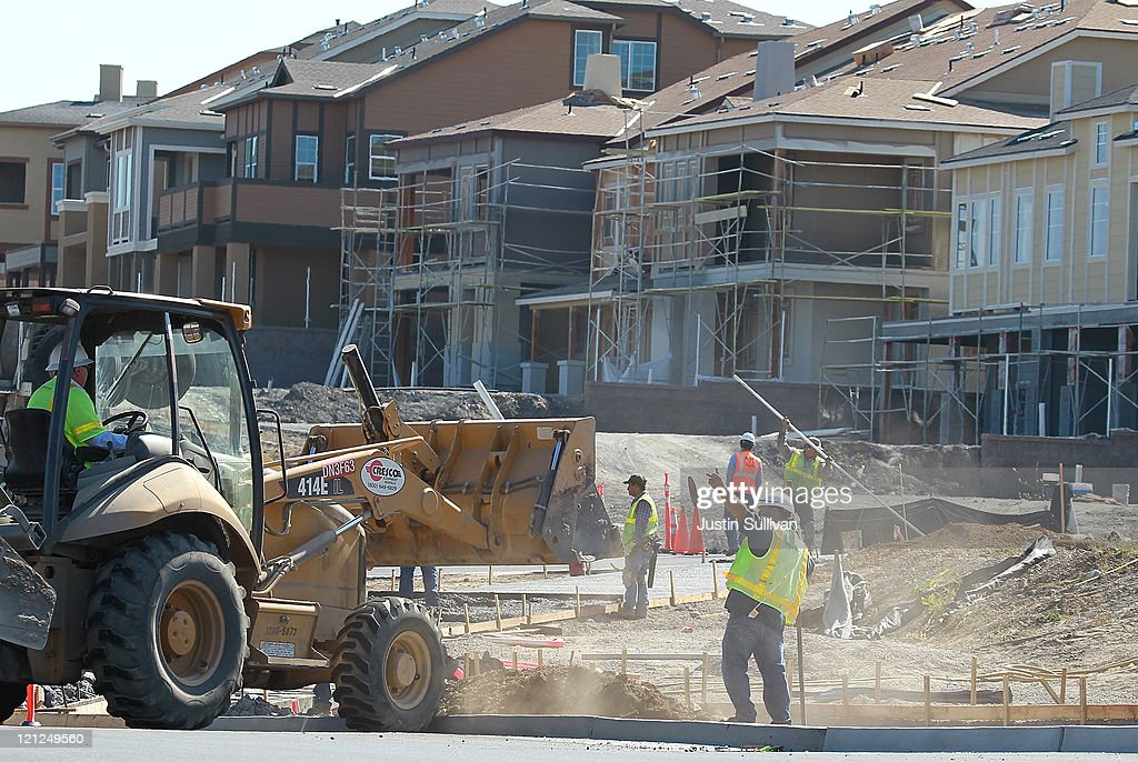 Construction workers are seen working at a new housing development on August 16, 2011 in Petaluma, California. The Commerce Department reported that new home construction fell in July with homebuilders beginning construction on a seasonally adjusted 604,000 homes for the month, a 1.5 percent decline from June.