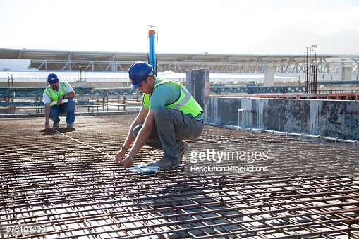 construction workers arranging rebar at construction site stock photo rebar worker