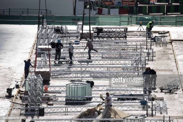 Construction workers arrive for work on a building site on the Trocadero in Paris France on Thursday Sept 21 2017 French unions will try to show...