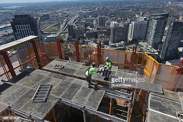 Construction workers assemble a deck on the 50th floor at the Millennium Tower one of several highrises under development in Boston Aug 12 2015