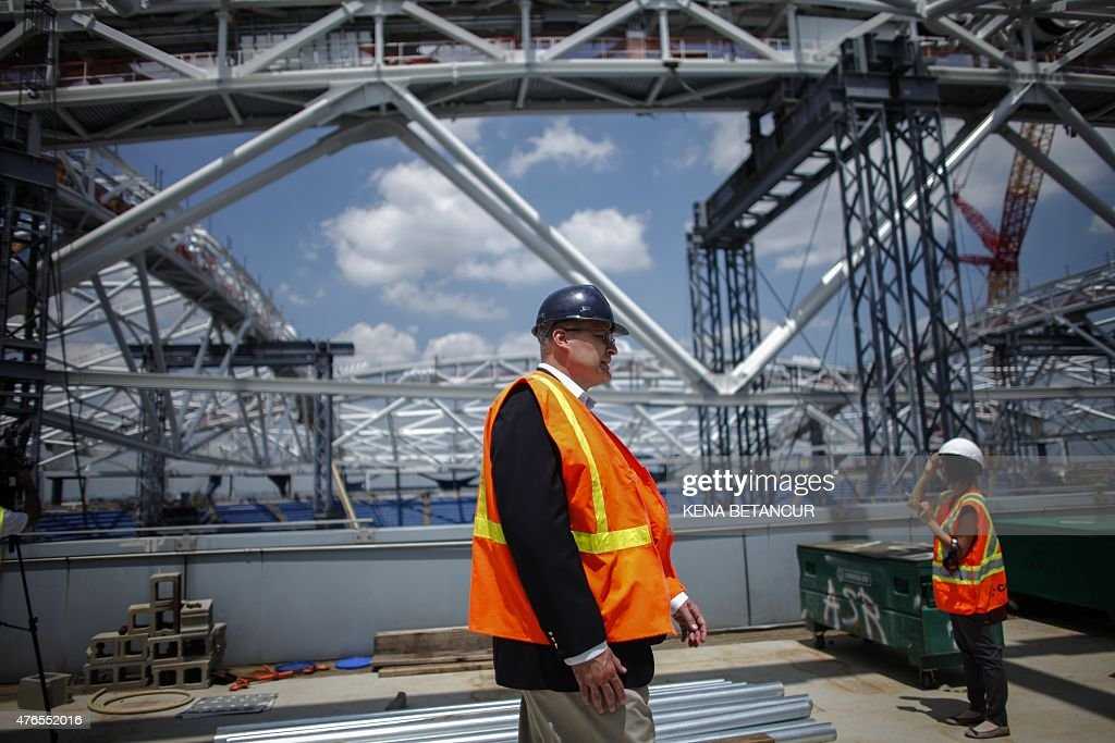 Construction workers at Arthur Ashe Stadium where the final piece of steel for the roof structure is being installed at the USTA Billie Jean King...